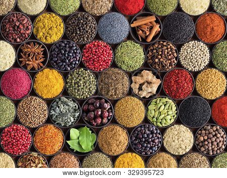 Spices And Herbs Background. Large Set Of Seasoning Top View. Colorful Condiments For Label Prints O
