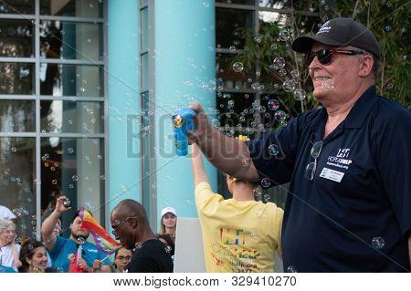 Orlando, Florida. October 12, 2019. Nice Man With Bubble Gun  In Come Out With Pride Orlando Parade