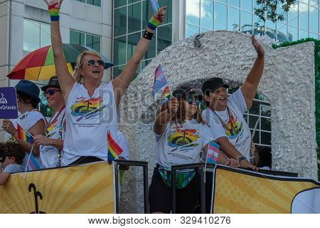 Orlando, Florida. October 12, 2019. Nice People In Chariot At Come Out With Pride Orlando Parade At