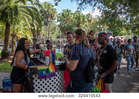 Orlando, Florida. October 12, 2019. People Buying Drinks In Come Out With Pride Orlando Parade At La