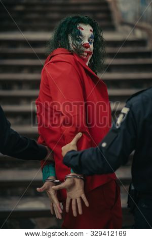 Dnipro, Ukraine - October 22, 2019: Two Policemen Portrays Arrest Of Cosplayer In The Image Of A Cra