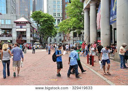 Boston, Usa - June 9, 2013: People Visit Market Street In Boston. 4.1 Million People Live In Boston