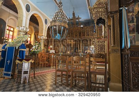 Trikala Greece - July 25 2019; Inside Of Ornate Greek Orthodox Church With Chandelier And Intricate
