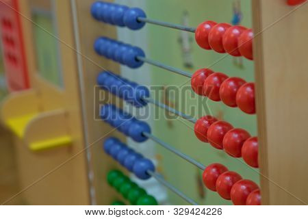 Toy Abacus To Learn Counting. Colorful Children Counting Frame For Kids. Top Side View.abacus With R