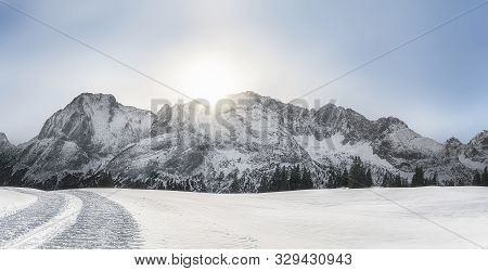 Bright Winter Landscape With Snow-capped Alps Mountain Peaks, Snow-covered Nature, And Snowy Alpine