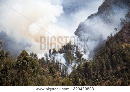 Fire In Mountain Forest. Aerial View Forest Fire And Smoke On Slopes Hills. Wild Fire In Mountains I