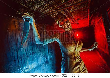 Scary Undead Zombie In The Dark Corridor. Halloween Theme.