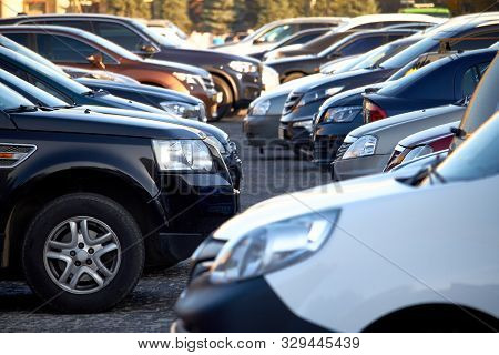 Lots Of Cars In An Open Parking Lot, Selective Focus