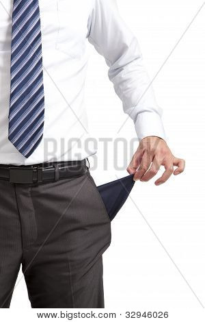 businessman pulling out empty pocket