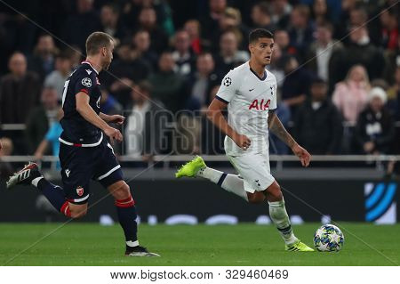 LONDON, ENGLAND - OCTOBER 22 2019: Tottenham's Erik Lamela  runs with the ball during the UEFA Champions League match between Tottenham Hotspur and Red Star Belgrade, at Tottenham Hotspur Stadium
