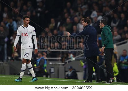 LONDON, ENGLAND - OCTOBER 22 2019: Tottenham's Head Coach Mauricio Pochettino issues instructions to Dele Alli during the UEFA Champions League match between Tottenham Hotspur and Red Star Belgrade