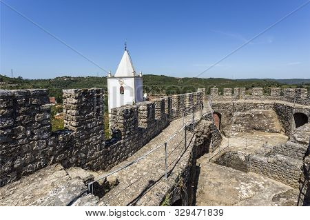 Penela - August 20, 2019: Detail Of The Parapet, Merlons, Crenels And Arrow Loops Of The Castle Of P