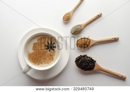 Traditional Indian Masala Chai Tea With Spices - Cinnamon, Cardamom, Anise, White Background. Top Vi