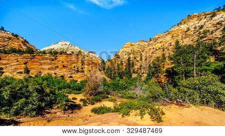 The White, Yellow And Orange Colors Of The Sandstone Mountains And Mesas Along The Zion-mt.carmel Hi