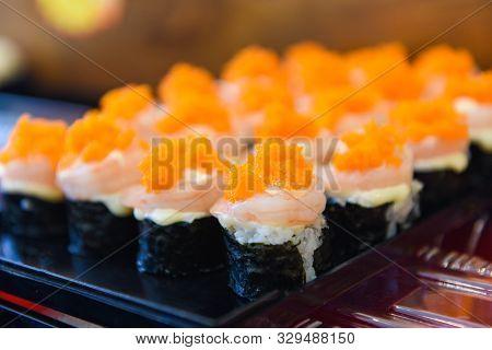 Japanese Food Shrimp Sushi Roll Rice With Tobiko Egg Is Orange (flying Fish Roe) Nori In The Restaur