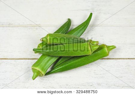 Green Okra / Fresh Fresh Young Okra For Food On White Wooden , Ochro Gumbo