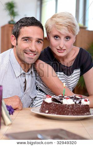 Couple with birthday cake
