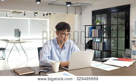 Young Asian Businessman Concentrate On Working With Laptop Computer At Office, Asian Office Man Comt