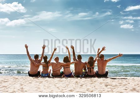 Group Friends Is Having Fun At Sea Beach. Sea Vacations Concept