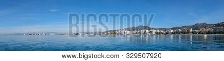 Seascape In Roses, Catalunya, Spain. City On The Coast On Blue Sky Background. Beautiful Panoramic V