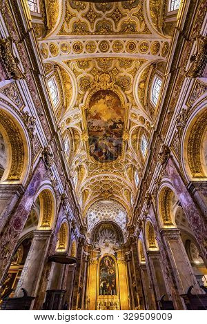 Rome, Italy - March 24, 2019  Tall Arches Nave Ceiling Frescoes Saint Louis Of French Basilica Churc