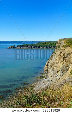 View of shoreline and cliffs in Cape Enrage, New Brunswick, Canada poster