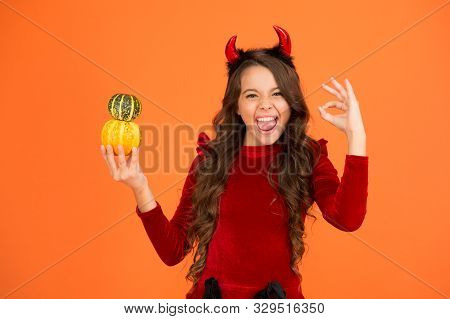 Ok To Nightmare. Happy Girl With Pumpkins Show Ok Sign. Small Child With Devil Look Smile With Ok Ha