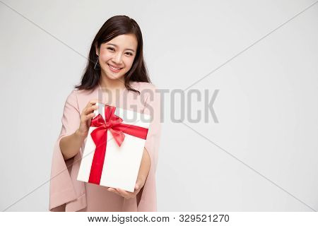 Happy Beautiful Asian Woman Smile With Gift Box Isolated On White Background. Teenage Girls In Love,