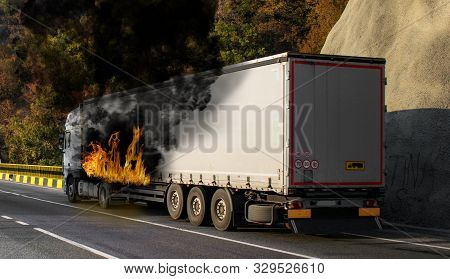 Truck Carrying Goods In Flames. The Tank Of The Truck Is In Fire. Fire Struck The Truck. Danger Of E
