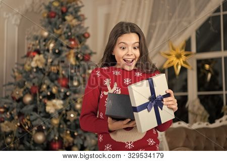 Feast Of Christmas. Delivery Christmas Gifts. Cute Little Child Girl With Xmas Present. Happy New Ye