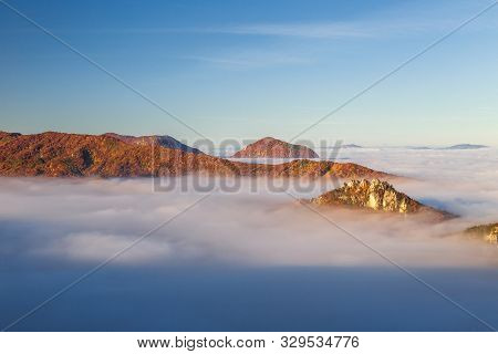 Mountain Peaks Over Misty Autumn Landscape. Morning Inversion In The Sulov Rock Mountains, Slovakia