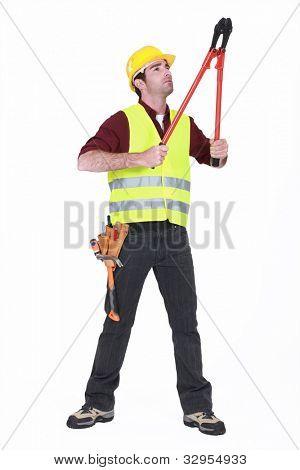 Worker using bolt cutters
