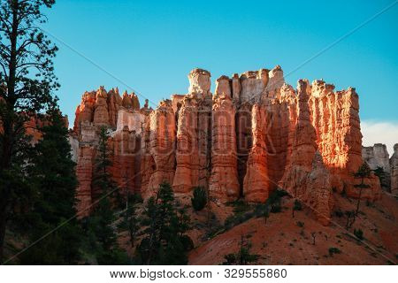 Beautiful Bryce Canyon National Park In Utah, Usa. Orange Rocks, Blue Sky. Giant Natural Amphitheate