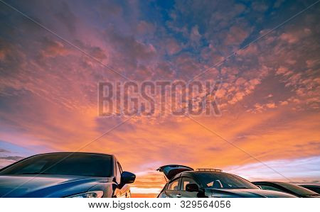 Car Parked At Outdoor Car Parking Lot Of Campsite With Beautiful Sunset Sky. Car Drive For Adventure