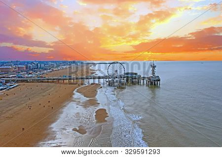 Aerial from the Pier from Scheveningen in the Netherlands at sunset