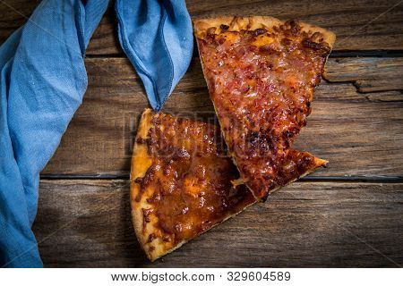 Slice Of Homemade Bbq Pizza On Wooden Table