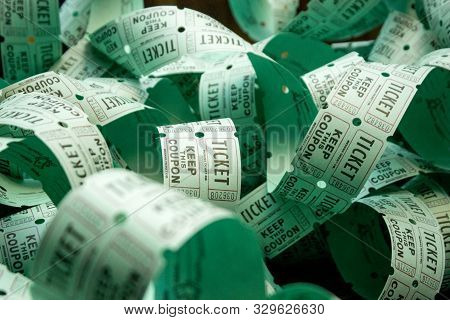 Unrolled Roll Of Green Admit One Raffle Tickets For Charity Or Entertainment Lottery With Winning Pr