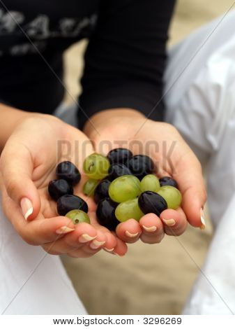 Grapes In The Hands