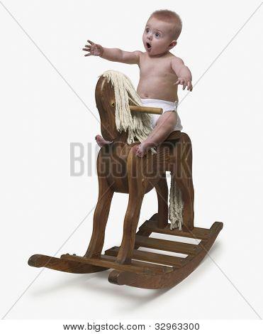 Baby riding rocking horse