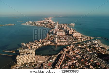Aerial panoramic photography drone point of view La Manga del Mar Menor townscape and seaside spit of Mediterranean Sea, Mar Menor in Region of Murcia, Spain poster