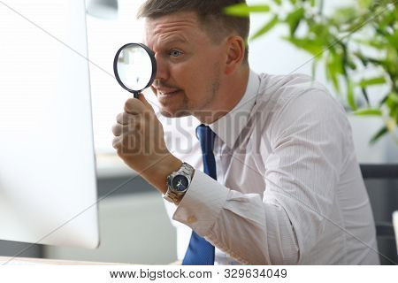 Portrait Of Businessman In Office At Computer. Manager In Classic Shirt And Tie Looking At Pc Monito