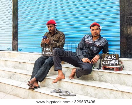 Rishikesh, India - Circa April 2018. Ear Cleaners On The Streets Of Rishikesh.