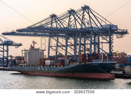 Laem Chabang Seaport, Thailand - March 17, 2019: Blue-red Small Container Ship Mol Sparkle, Panama F