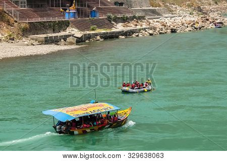 Rishikesh, India - Circa April 2018. Boating On Ganga River In Rishikesh.