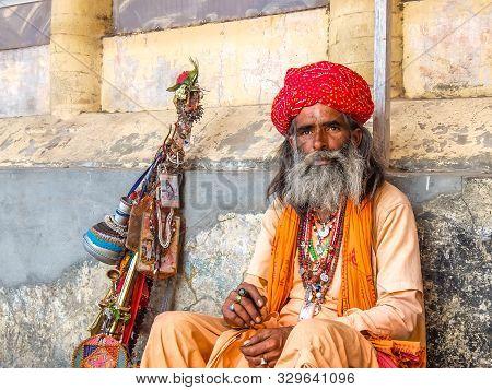 Rishikesh, India - Circa April 2018. Sadhu Sitting On The Street Of Rishikesh.