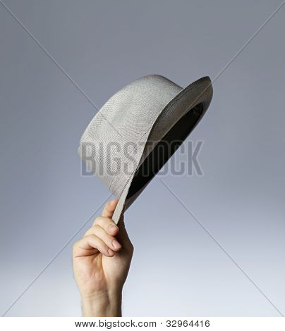 Man tipping his vintage trilby hat.
