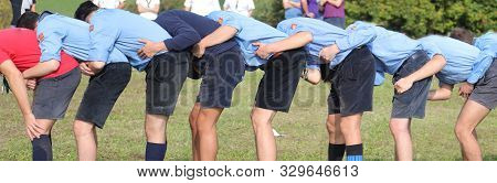 Many Boy With Scout Uniform Playing At Leapfrog Outdoor In Summer