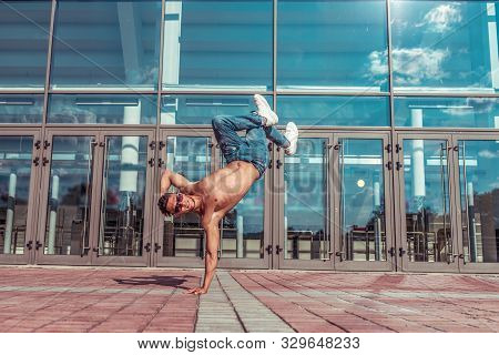 Male Dancer Standing One Arm, Jumping Glass Windows Dancing Jump, Summer City, Hip Hop Style Break D