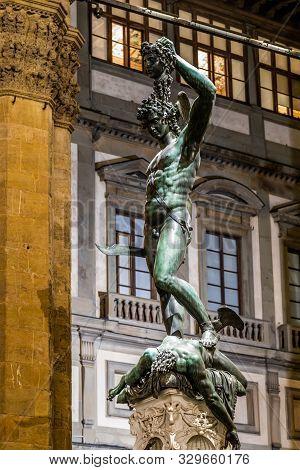 Bronze statue of Perseus holding the head of Medusa in Florence, Piazza della Signoria square, made by Benvenuto Cellini in 1545 poster