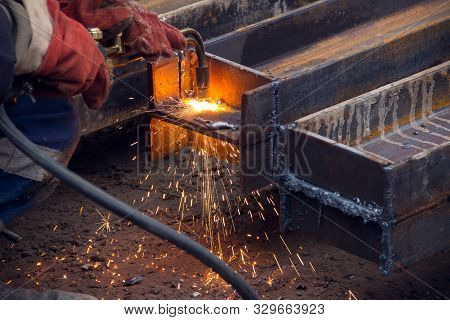 Cutting A Steel Beam With A Gas Torch. Industrial Metal Cutting. The Process Of Preparing A Steel Be